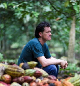 Willie Harcourt Cooze sitting on cacao pods