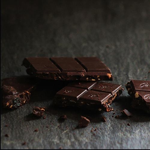 Willie's Cacao Hazelnut Raisin chocolate. 70% dark chocolate made bean to bar and studded with hazelnuts and raisins. Vegan.