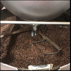 Cooling the Surabay beans that have just been roasted in our antique ball roaster. Bean to bar chocolate making.