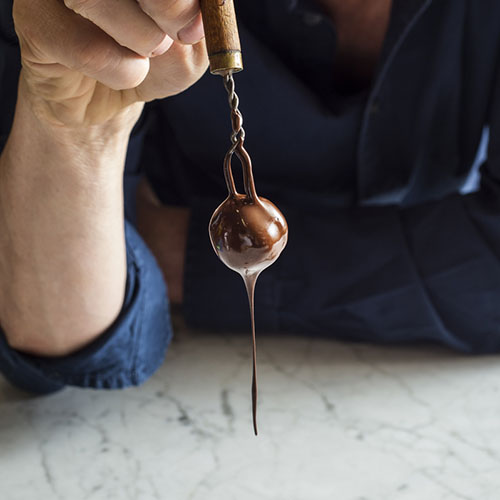 Willie Harcourt Cooze dipped a Praline Truffle in dark chocolate